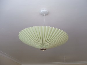 These are the little light shades that look like the little umbrellas in mixed drinks. This is pretty tame. The one in the hall looks like it came from a rather large pina colada. I've been informed we'll be swapping these out for something....anything....else.